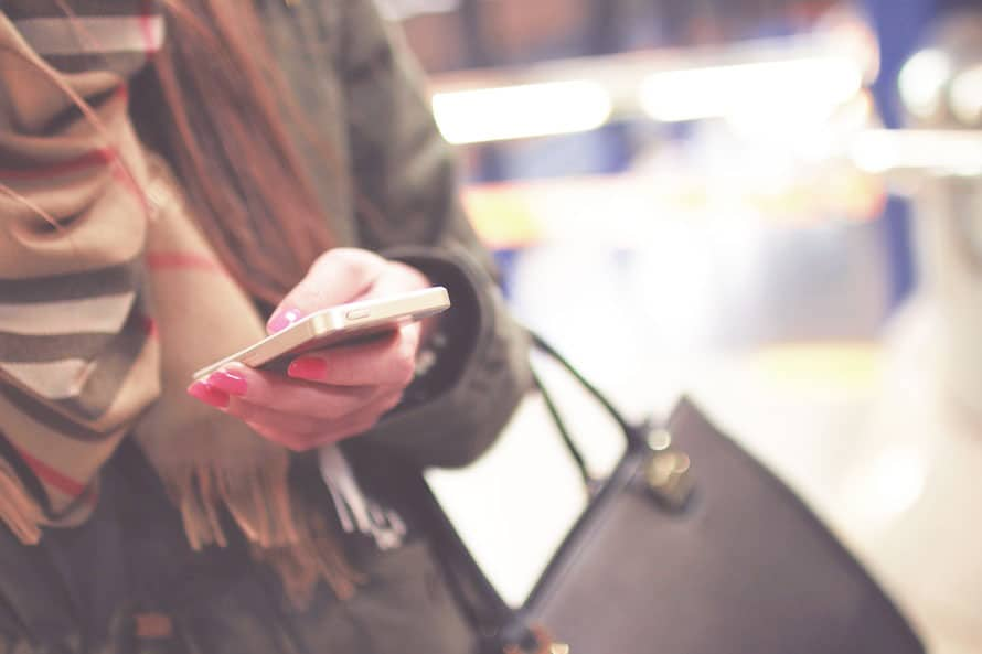 woman-checking-prices-phone